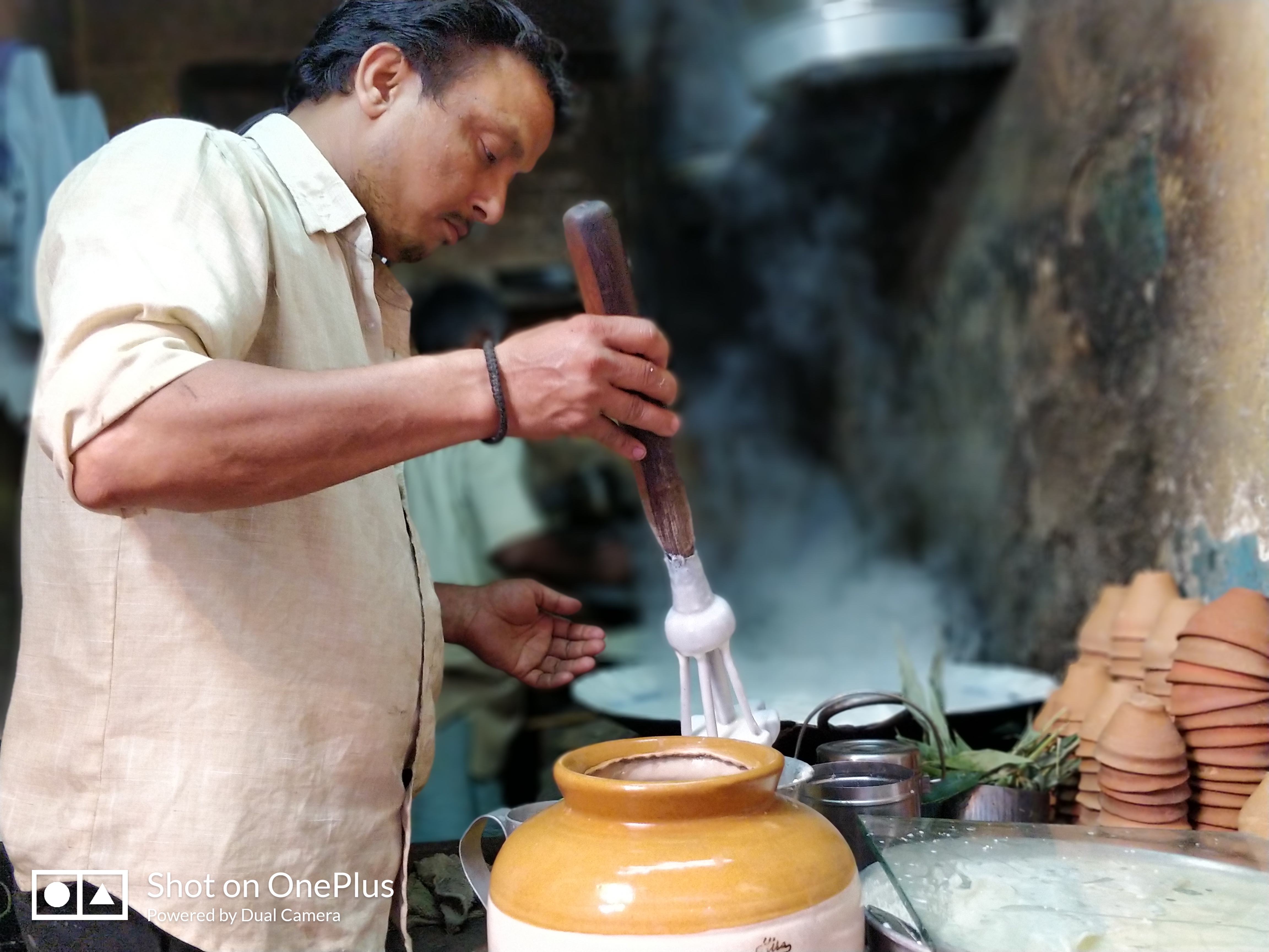 Lassi making with hand in Varanasi