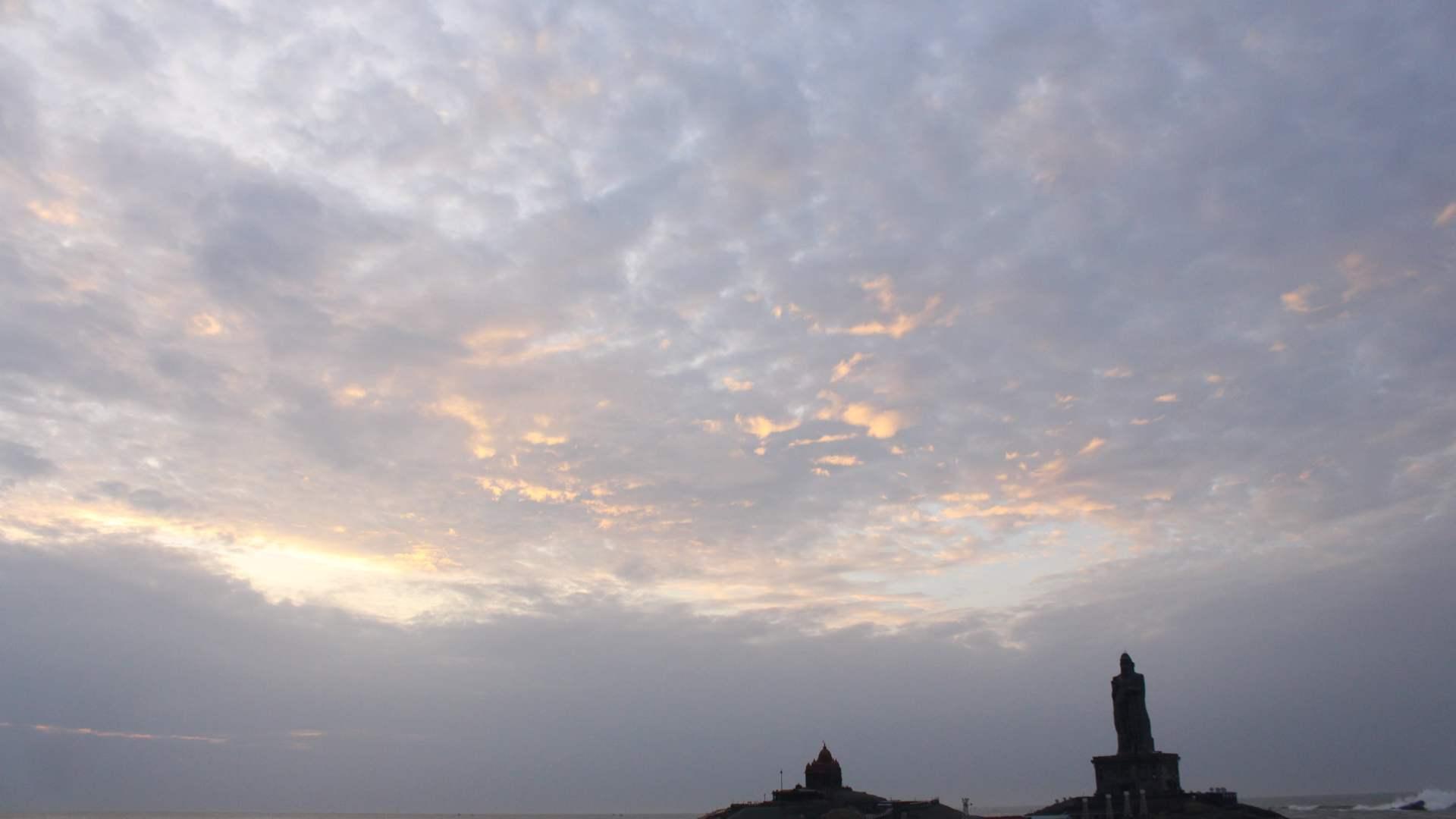 Sunrise at Vivekananda Rock Memorial and Thiruvalluvar Statue from Kanyakumari