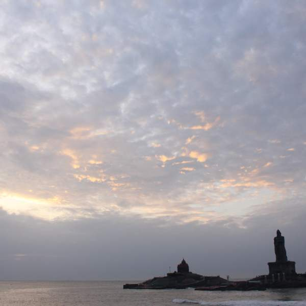 Sunrise at Vivekananda Rock Memorial and Thiruvalluvar Statue from Kanyakumari